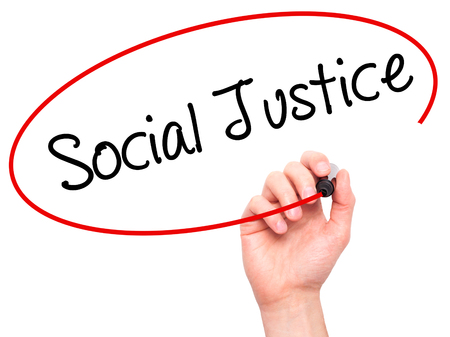 race relations: Man Hand writing Social Justice with black marker on visual screen. Isolated on white. Business, technology, internet concept. Stock Photo Stock Photo