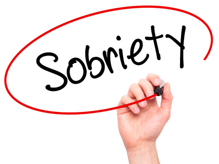 sobriety: Man Hand writing Sobriety with black marker on visual screen. Isolated on white. Business, technology, internet concept. Stock Photo