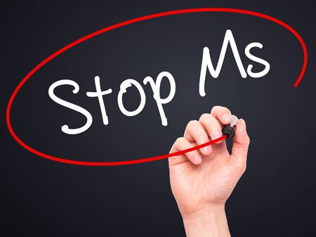 spasms: Man Hand writing Stop Ms with black marker on visual screen. Isolated on black. Business, technology, internet concept. Stock Photo