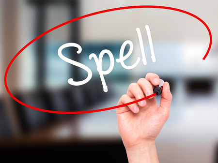 grammatical: Man Hand writing Spell with black marker on visual screen. Isolated on office. Business, technology, internet concept. Stock Photo Stock Photo