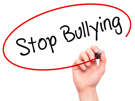 Man Hand writing Stop Bullying with black marker on visual screen. Isolated on white. Business, technology, internet concept. Stock Photo Stock Photo - 52991544