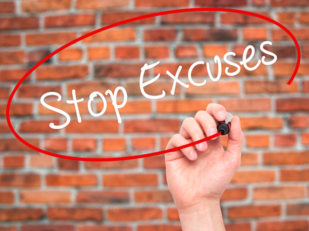 no mistake: Man Hand writing  Stop Excuses  with black marker on visual screen. Isolated on background. Business, technology, internet concept. Stock Photo