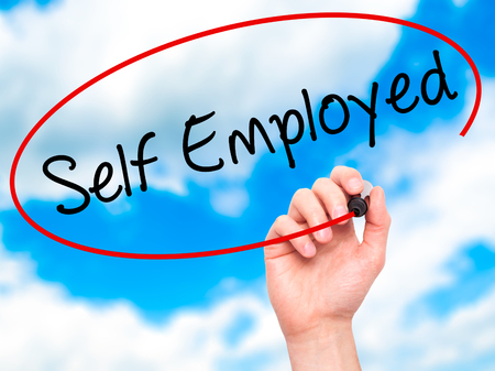 self employed: Man Hand writing Self Employed with black marker on visual screen. Isolated on sky. Business, technology, internet concept. Stock Photo Stock Photo