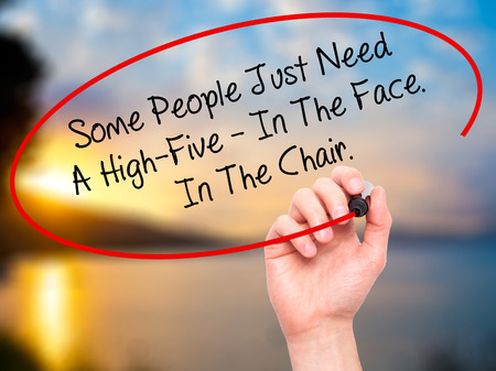 stupidity: Man Hand writing Some People Just Need A High-Five - In The Face. In The Chair  with black marker on visual screen. Isolated on nature. Business, technology, internet concept. Stock Photo