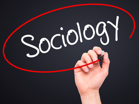 infeasible: Man Hand writing Sociology  with black marker on visual screen. Isolated on background. Business, technology, internet concept. Stock Photo