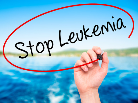 leucemia: Man Hand writing  Stop Leukemia with black marker on visual screen. Isolated on background. Business, technology, internet concept. Stock Photo
