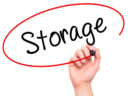 self storage: Man Hand writing Storage with black marker on visual screen. Isolated on white. Business, technology, internet concept. Stock Photo