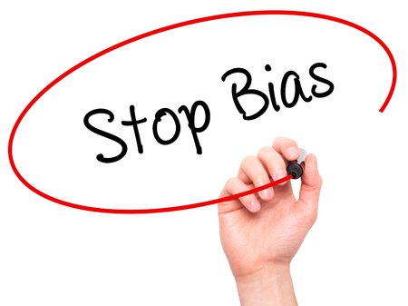 biased: Man Hand writing Stop Bias with black marker on visual screen. Isolated on white. Business, technology, internet concept. Stock Photo