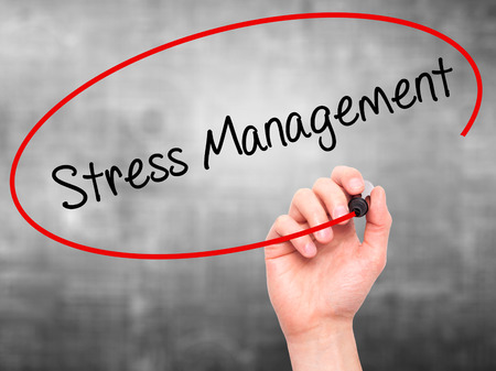 pressured: Man Hand writing Stress Management with black marker on visual screen. Isolated on grey. Business, technology, internet concept. Stock Photo Stock Photo