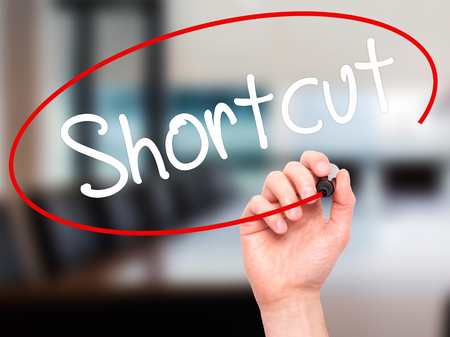 shortcut: Man Hand writing Shortcut with black marker on visual screen. Isolated on office. Business, technology, internet concept. Stock Photo Stock Photo