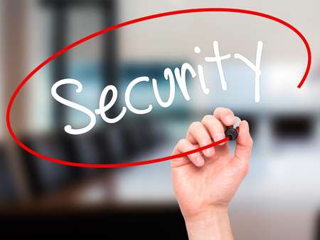 cyber defence: Man Hand writing Security with black marker on visual screen. Isolated on background. Business,  technology, internet concept. Stock Photo Stock Photo