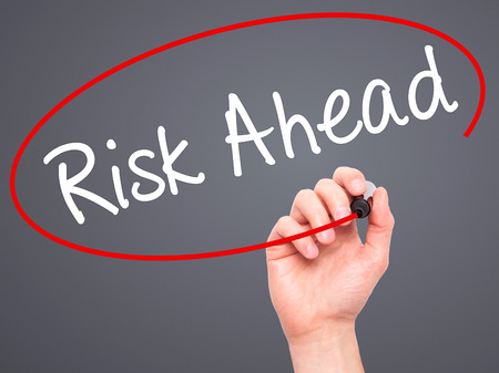 risk ahead: Man Hand writing Risk Ahead with black marker on visual screen. Isolated on grey. Business, technology, internet concept. Stock Image Stock Photo