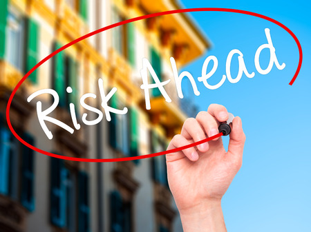 risk ahead: Man Hand writing Risk Ahead with black marker on visual screen. Isolated on city. Business, technology, internet concept. Stock Image Stock Photo