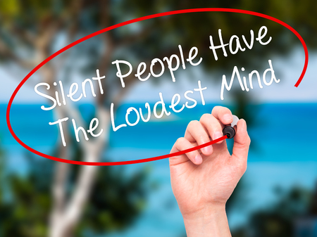 loudest: Man Hand writing Silent People Have The Loudest Mind with black marker on visual screen. Isolated on background. Business, technology, internet concept. Stock Photo