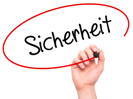 sicherheit: Man Hand writing Sicherheit (Safety in German) with black marker on visual screen. Isolated on white. Business,  internet concept. Stock Photo Stock Photo