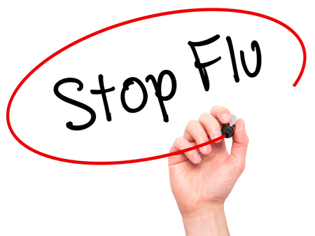 not painted: Man Hand writing Stop Flu with black marker on visual screen. Isolated on background. Business,  technology, internet concept. Stock Photo Stock Photo