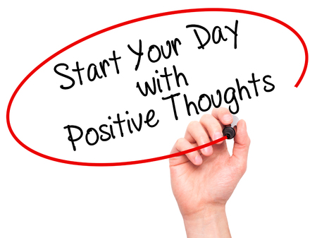 positiveness: Man Hand writing Start your Dat with Positive Thoughts with black marker on visual screen. Isolated on white. Business, technology, internet concept. Stock Photo Stock Photo