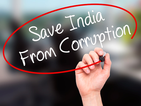 marchers: Man Hand writing Save India From Corruption with black marker on visual screen. Isolated on background. Business, technology, internet concept. Stock Photo