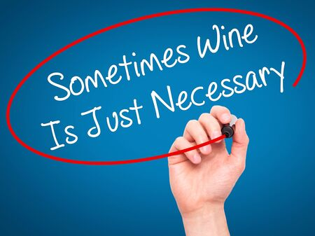 necessary: Man Hand writing Sometimes Wine Is Just Necessary with black marker on visual screen. Isolated on blue. Business, technology, internet concept. Stock Photo
