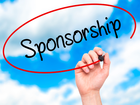 sponsorship: Man Hand writing Sponsorship  with black marker on visual screen. Isolated on sky. Business, technology, internet concept. Stock Photo