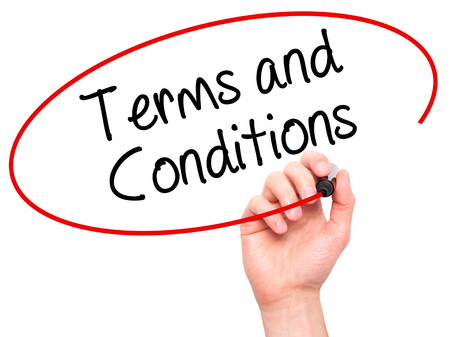 Man Hand writing Terms and Conditions with black marker on visual screen. Isolated on white.