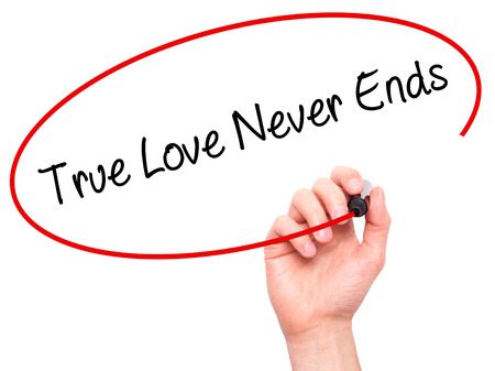 in loving memory: Man Hand writing True Love Never Ends with black marker on visual screen. Isolated on white. Business, technology, internet concept. Stock Photo