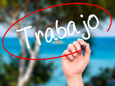 Man Hand writing Trabajo  ( work in Spanish) with black marker on visual screen. Isolated on background. Business, technology, internet concept. Stock Photo