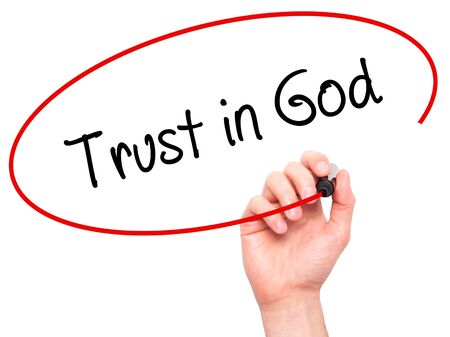 Man Hand writing Trust in God with black marker on visual screen. Isolated on white. Business, technology, internet concept. Stock Photo