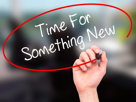 Man Hand writing Time For Something New with black marker on visual screen. Isolated on office. Business, technology, internet concept. Stock Photo Stock Photo