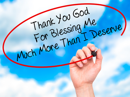 deserve: Man Hand writing Thank You God For Blessing Me Much More Than I Deserve with black marker on visual screen. Isolated on sky. Business, technology, internet concept. Stock Photo