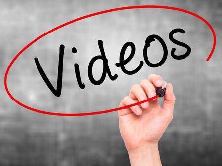 infomercial: Man Hand writing Videos with black marker on visual screen. Isolated on grey. Business, technology, internet concept. Stock Image