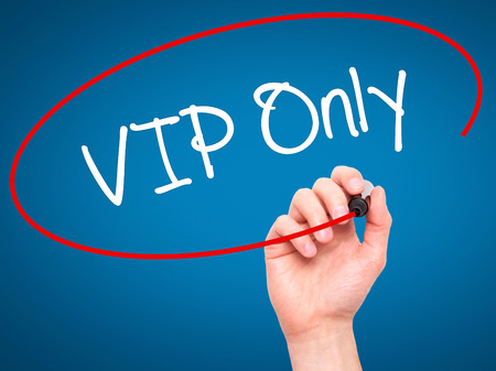 no pase: Man Hand writing VIP Only   with black marker on visual screen. Isolated on background. Business, technology, internet concept. Stock Photo