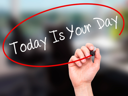 test deadline: Man Hand writing Today Is Your Day with black marker on visual screen. Isolated on background. Business, technology, internet concept. Stock Photo