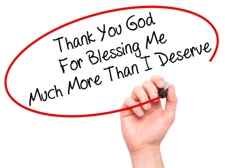 deserve: Man Hand writing Thank You God For Blessing Me Much More Than I Deserve with black marker on visual screen. Isolated on white. Business, technology, internet concept. Stock Photo