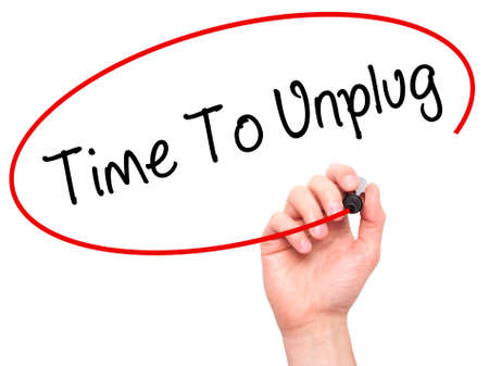 unplug: Man Hand writing Time To Unplug with black marker on visual screen. Isolated on white. Business, technology, internet concept. Stock Photo Stock Photo