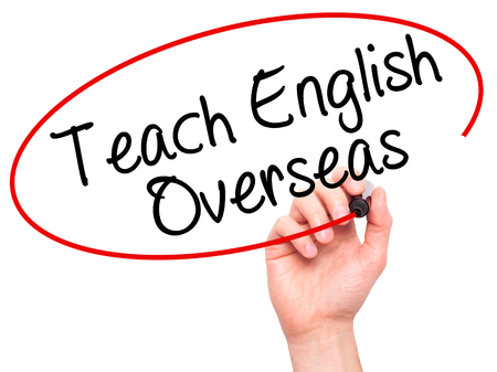 Man Hand writing Teach English Overseas with black marker on visual screen. Isolated on white. Business, technology, internet concept. Stock Photo Stock Photo