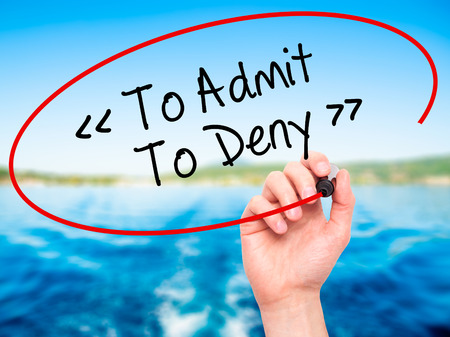 denying: Man Hand writing To Admit - To Deny with black marker on visual screen. Isolated on background. Business, technology, internet concept. Stock Photo
