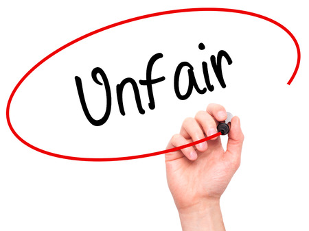 unfair: Man Hand writing Unfair with black marker on visual screen. Isolated on background. Business, technology, internet concept. Stock Photo