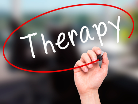 visual therapy: Man Hand writing Therapy with black marker on visual screen. Isolated on office. Business, technology, internet concept. Stock Photo