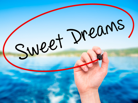 endearment: Man Hand writing Sweet Dreams with black marker on visual screen. Isolated on nature. Business, technology, internet concept. Stock Photo