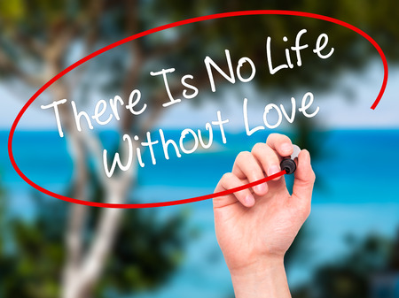 intrinsic: Man Hand writing There Is No Life Without Love with black marker on visual screen. Isolated on nature. Business, technology, internet concept. Stock Photo Stock Photo