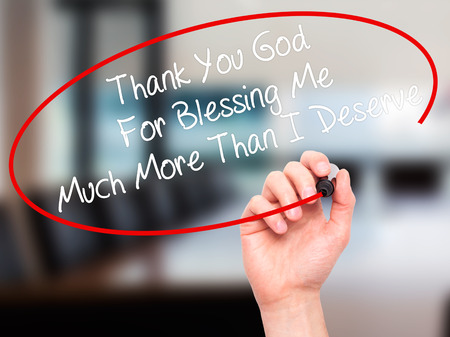 deserve: Man Hand writing Thank You God For Blessing Me Much More Than I Deserve with black marker on visual screen. Isolated on office. Business, technology, internet concept. Stock Photo Stock Photo