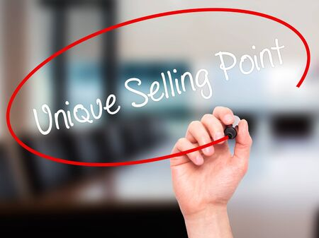 selling points: Man Hand writing Unique Selling Point with black marker on visual screen. Isolated on office. Business, technology, internet concept. Stock Photo Stock Photo