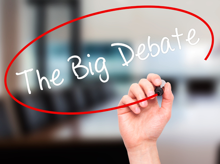 talk big: Man Hand writing The Big Debate with black marker on visual screen. Isolated on background. Business, technology, internet concept. Stock Photo