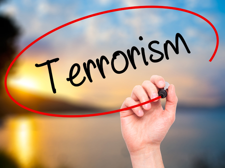 cyber terrorism: Man Hand writing Terrorism with black marker on visual screen. Isolated on nature. Business, technology, internet concept.