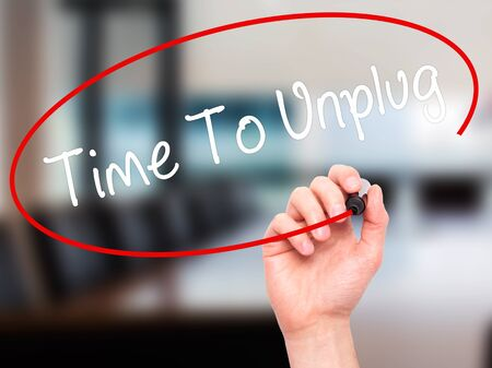 unplug: Man Hand writing Time To Unplug with black marker on visual screen. Isolated on office. Business, technology, internet concept. Stock Photo