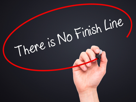 not ready: Man Hand writing There is No Finish Line with black marker on visual screen.