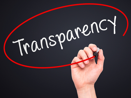 apparent: Man Hand writing Transparency with marker on transparent wipe board. Isolated on black. Business, internet, technology concept.  Stock Photo Stock Photo
