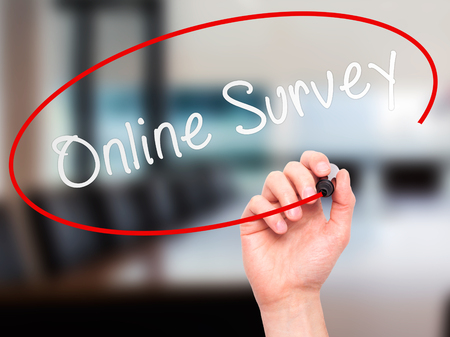 electronic voting: Man hand writing Online Survey on visual screen. Business,help, internet, technology concept. Isolated on office. Stock Photo Stock Photo