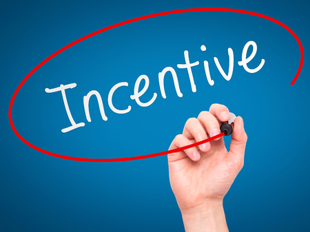 incentive: Man Hand writing Incentive with marker on transparent wipe board. Isolated on blue. Business, internet, technology concept.  Stock Photo Stock Photo